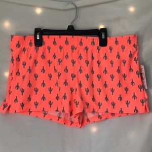 Orange stretchy workout pants with cactuses